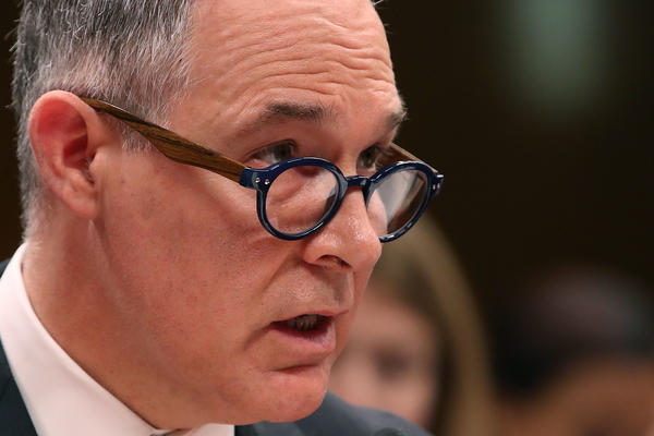 EPA Administrator Scott Pruitt, testifies during a Senate hearing last month. Pruitt is facing multiple investigations for his official spending. According to a memo released by House Democrats, one of Pruitt's aides said he asked her to run personal errands on his behalf.