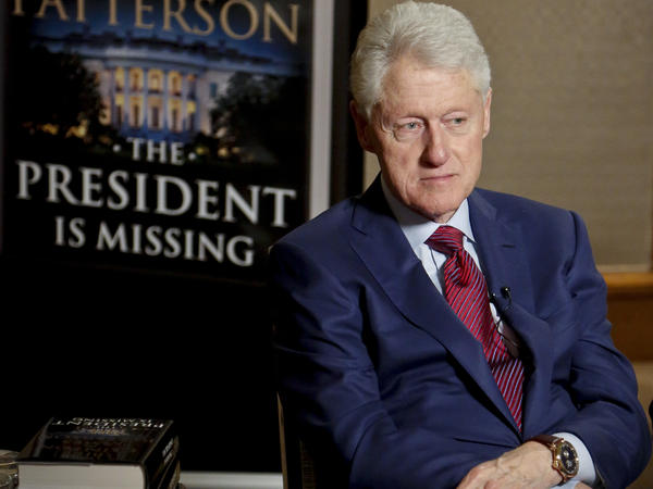 Former President Bill Clinton listens during a Monday interview about <em>The President is Missing</em>, a novel he wrote with James Patterson.