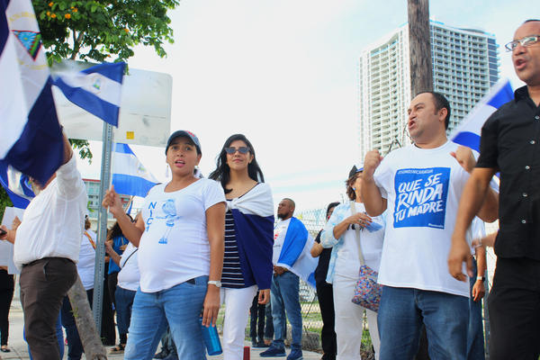 Protesters wave Nicaragua flags across the street from Miami Fashion Week shows at Ice Palace Films Studios on Friday, June 1, 2018. Nicaraguan designer Shantall Lacayo cancelled her show after uproar over her ties to Nicaraguan President Daniel Ortega.