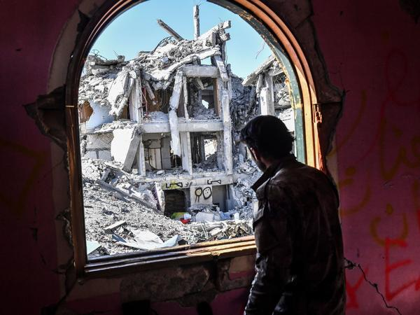 A member of the Syrian Democratic Forces, the rebel group backed by the U.S.-led coalition, looks out upon the ruins of Raqqa last October, toward the end of the coalition's campaign to dislodge the Islamic State from its former stronghold.