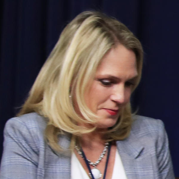 """Kelly Sadler, shown in March, is no longer employed as a special assistant to President Trump. Last month, after Sen. John McCain urged senators to vote against Gina Haspel's nomination to head the CIA, Sadler reportedly said, """"It doesn't matter, he's dying anyway."""""""