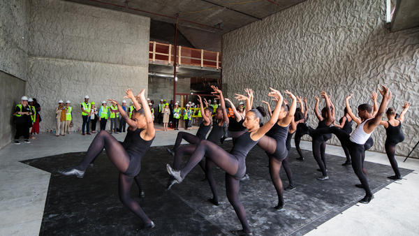 Dancers from the Duke Ellington School of the Arts gave reporters on the hard-hat tour an idea of how The REACH will look when it's done.