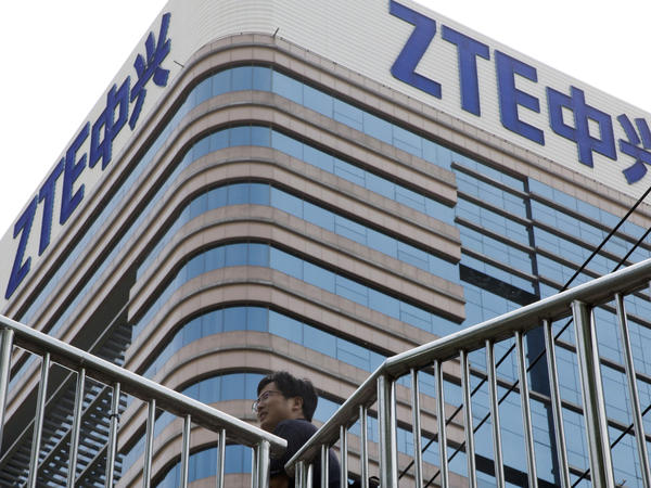 A man walks past a building with the ZTE logos in Beijing in a photo taken last month.