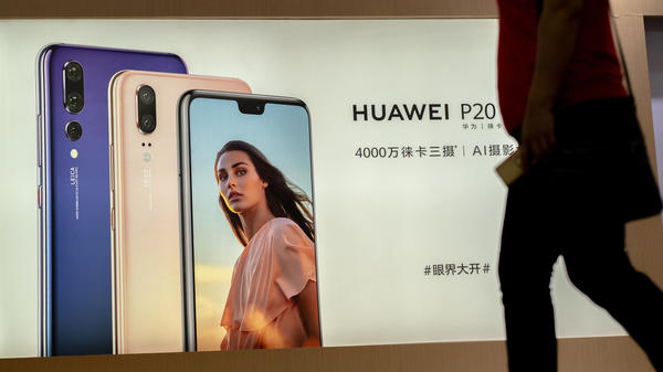 Facebook's data-sharing deals with device-makers included China's Huawei — a company viewed with suspicion by U.S. intelligence agencies. Here, an ad for the Huawei P20 smartphone is seen in China last month.