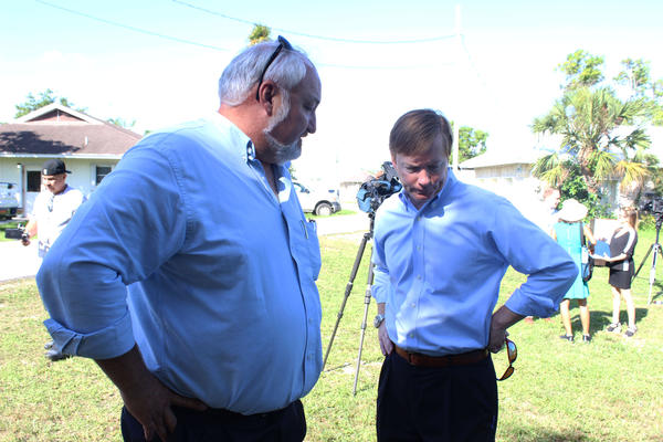 Florida Commissioner of Agriculture Adam Putnam (right) discusses fruit fly eradication plans with Charles LaPradd, Agriculture Manager for Miami-Dade near the USDA ARS Subtropical Horticultural Research Station, on Tuesday, June 5, 2018.