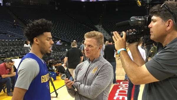 Quinn doing interviews during Media Day before the NBA Finals began at the Warriors' home court, Oracle Arena, in Oakland, Calif.
