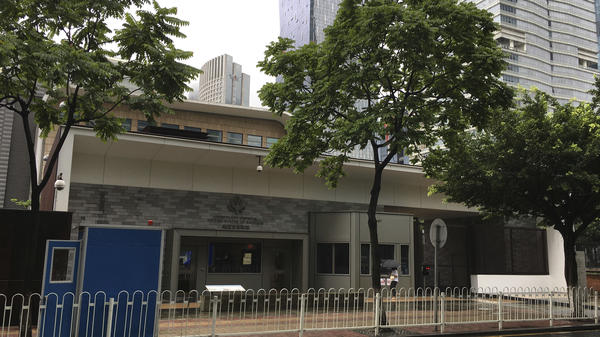 The U.S. Consulate building in Guangzhou in southern China pictured Thursday. More State Department employees have been evacuated.