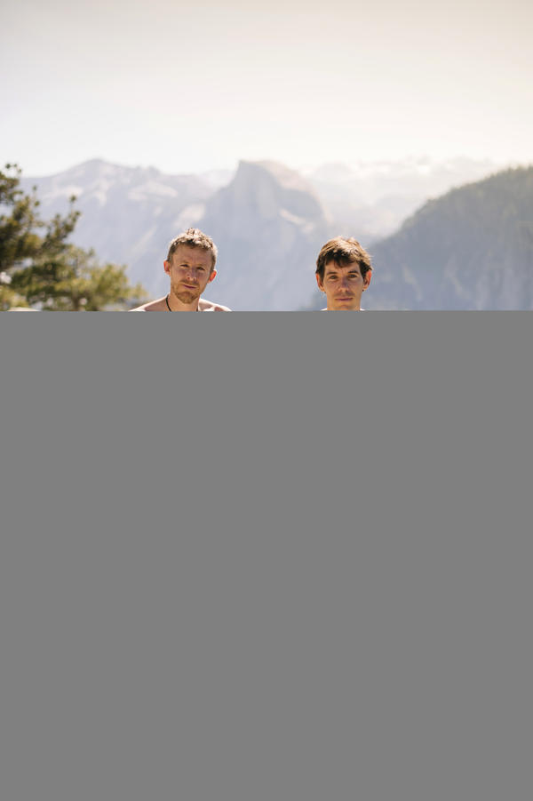 Tommy Caldwell and Alex Honnold pose for a portrait Sunday at the top of El Capitan in Yosemite National Park, Calif. Within days, the pair would go on to break their own record twice, including once in under 2 hours.