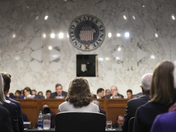 The Senate intelligence committee holds a confirmation hearing for CIA nominee Gina Haspel last month. A former top aide to the committee has been charged with three counts of making false statements to federal authorities.