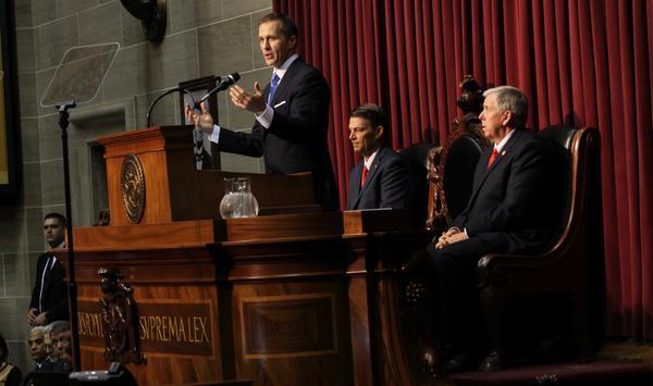 The full agreement between former Missouri Gov. Eric Greitens (center) and the St. Louis Circuit Attorney's office was released Wednesday.