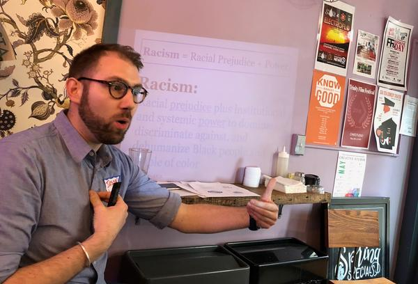 Trainer Jason Fredlund gives an anti-bias workshop to staff at Hartford's Story and Soil Coffee. The coffeehouse owners wanted to learn more about racial bias after the incident at Starbucks this spring.