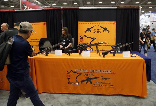 <p>AR-15s and AR-10s on display at the NRA convention in Dallas, Texas.</p>