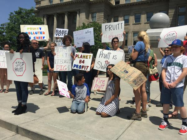 About two dozen protesters gathered in Boise in response to EPA director Scott Pruitt's brief appearance.