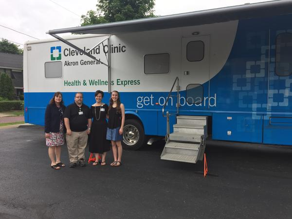 Dr. Jennifer Savitski (second from right) with Sue Hobson (left), Director of Community Relations for Cleveland Clinic Akron General, Michael Cassel, coordinator for the Health & Wellness Express, and Veronica Savitski.