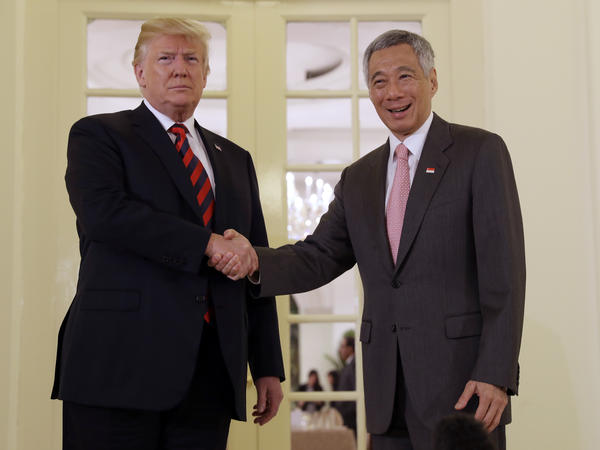 Singapore Prime Minister Lee Hsien Loong meets President Trump ahead of the summit with North Korean leader Kim Jong Un on Monday.
