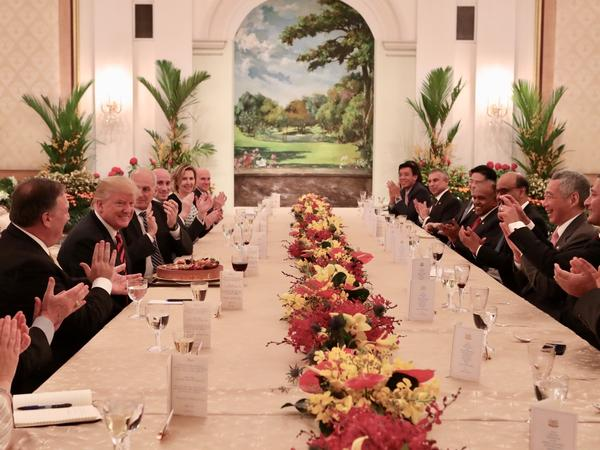 President Trump participates in a working luncheon hosted by Singapore's Prime Minister Lee Hsien Loong in Singapore on Monday. Officials from both delegations also attended the luncheon.