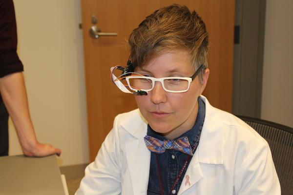 Nurse Rachel Walker, demonstrating one of her inventions.
