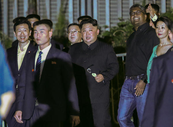 North Korea leader Kim Jong Un, center, is escorted by his security delegation as he visits Marina Bay in Singapore, Monday, June 11, 2018, ahead of Kim's summit with President Donald Trump.