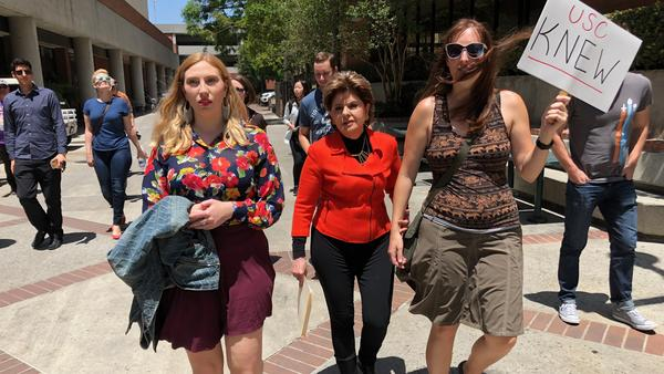Attorney Gloria Allred, center, marched with students and alumni at USC on Saturday.