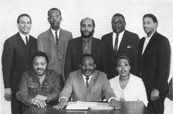 Dorothy Cotton sits for a photo with other staff members at the Southern Christian Leadership Conference, including the organization's president, Martin Luther King Jr.
