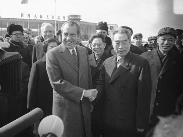President Richard Nixon and China's Premier Chou En-lai pose together at Shanghai Airport before the Nixon departs for the United States on Feb. 28, 1972.