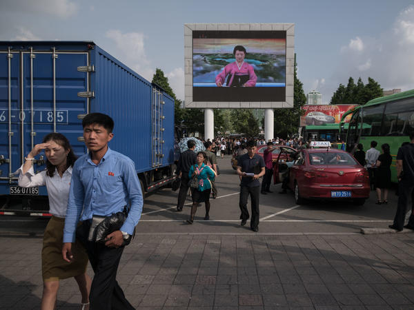North Korean news reader Ri Chun Hee is diplayed on a large television screen in Pyongyang on Tuesday. The news bulletin highlighted the trip to Singapore by North Korean leader Kim Jong Un, but not his meeting with President Trump.