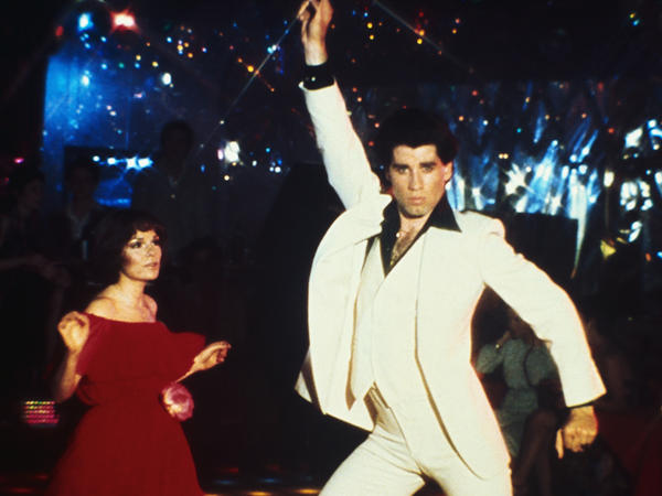 "John Travolta dances the night away in ""Saturday Night Fever."""