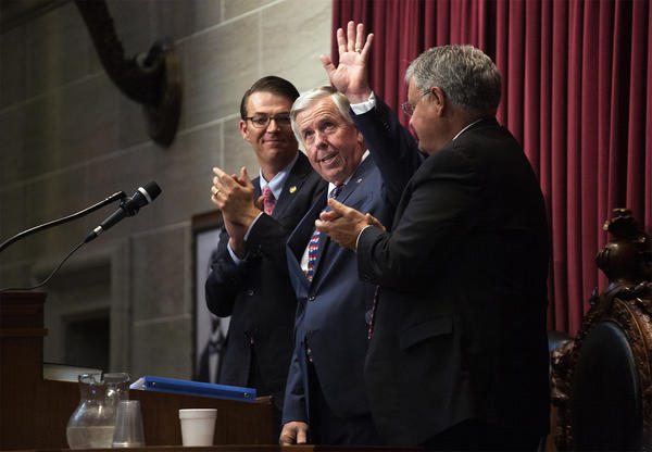Gov. Mike Parson flanked by House Speaker Todd Richardson, left, and Senate President Pro Tem Ron Richard after his first address to the General Assembly.