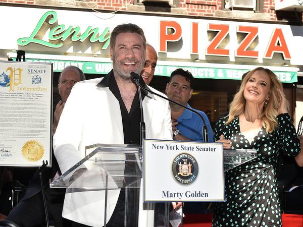 "John Travolta is honored at Lenny's Pizza in Brooklyn on ""John Travolta Day."""