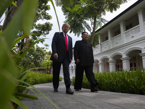 President Trump walks with North Korean leader Kim Jong Un on Tuesday on Sentosa Island in Singapore.