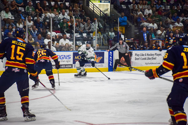 Everblades defenseman Logan Roe has the puck, as he faces three Eagles players.