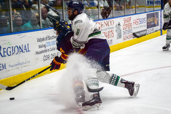 Everblades defenseman Derek Sheppard kicks up a flurry of shaved ice, as he attempts to get the puck back.
