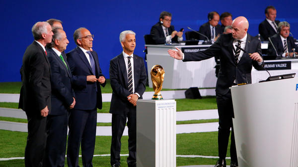 FIFA President Gianni Infantino, right, welcomes representatives of the united bid — from the U.S., Canada, and Mexico — as soccer's governing body selects its host for the 2026 FIFA World Cup during the 68th FIFA Congress in Moscow, Russia.