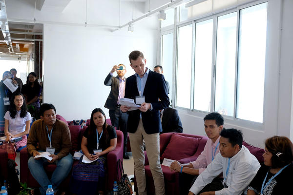 Jes Petersen, CEO of Phandeeyar, a Yangon-based tech hub, speaks to visiting U.S. government officials and civil society activists. Phandeeyar is one of several groups that have pressed Facebook to moderate its Burmese-language content to prevent hate speech.