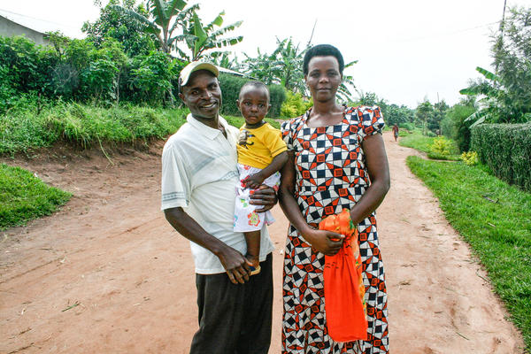 "Jean Marie Rukundo and his wife, Theodosie Uwambajimana, with their 2-year-old daughter. They've nicknamed her ""Rwamrec,"" the acronym for a resource center in Rwanda that taught Rukundo how to step up his game as a spouse and father. When he came with his wife to the delivery room for the child, she says that ""touched my heart."""