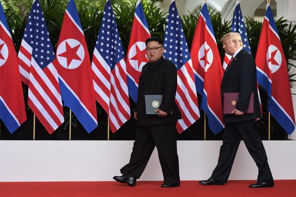 President Trump walks out with North Korea's leader Kim Jong Un after taking part in a signing ceremony at the end of their historic summit, at the Capella Hotel on Sentosa island in Singapore on June 12, 2018. (Anthony Wallace/AFP/Getty Images)