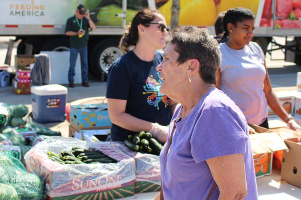 Vietnam-era veteran Diane Fike selects vegetables at the Austin, Tex. VA food pantry. Studies have found a growing number of veterans are food insecure, including many who fought in Iraq and Afghanistan.