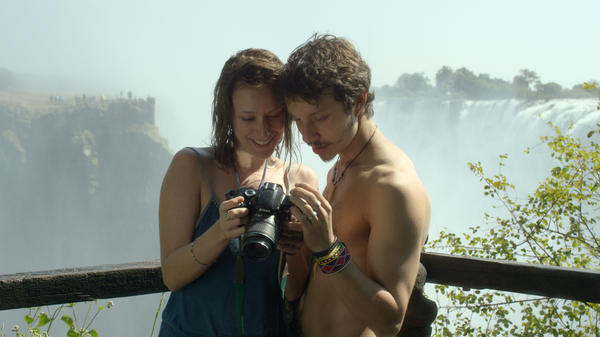 Chasing Waterfalls: Cristina (Caroline Abras) and Gabriel (João Pedro Zappa) check the filter in <em>Gabriel and the Mountain.</em>