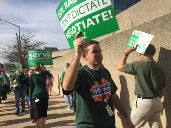 AFSCME members picket outside a state building in this 2016 file photo.