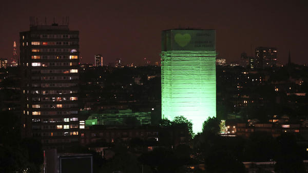 Grenfell Tower in west London is illuminated in green to mark a year since the devastating fire claimed 72 lives.