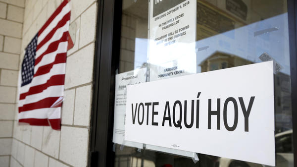 A sign announces a polling place in Spanish outside of the Harrison Community Center during New Jersey's primary election June 5.