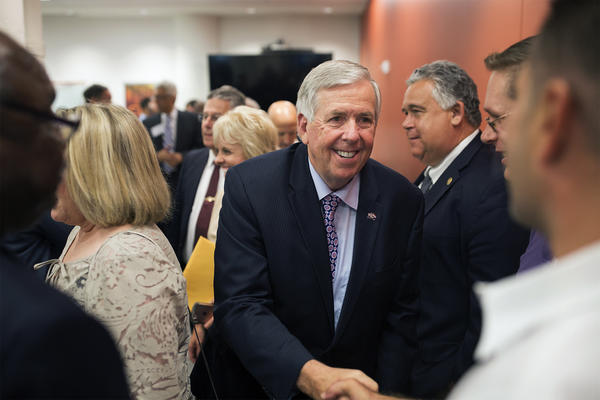Gov. Mike Parson greets attendees after a meeting with business and community leaders and elected officials at Cortex Innovation Community.