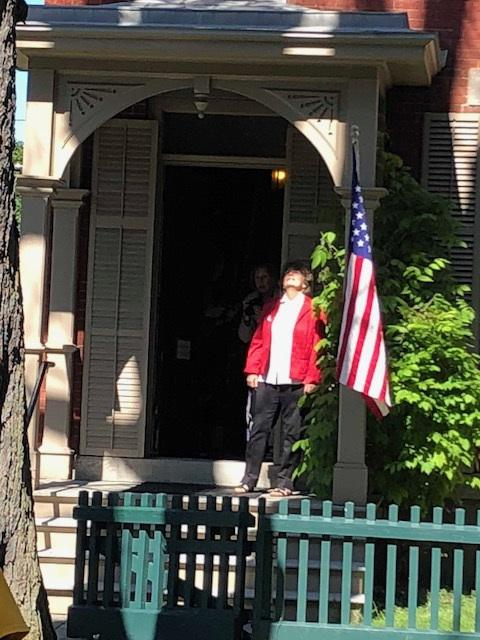 Deborah Hughes, exec. dir. of Susan B. Anthony House and Museum, watches removal of historic chestnut tree