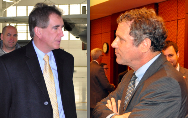 Jim Renacci (left) and Sherrod Brown both visited the Youngstown Air Reserve station in 2013 and spoke with colonels there.