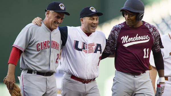 Rep. Steve Scalise (center) is helped off the field by Rep. Cedric Richmond (right) and Rep. Bran Wenstroup (left) after playing second base during the Congressional Baseball Game on Thursday in Washington, D.C.