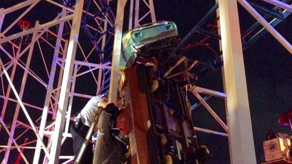 """""""Firefighters working as fast as they can to rescue 2 riders that are in a dangling rollercoaster car,"""" the Daytona Beach Fire Department tweeted late Thursday."""