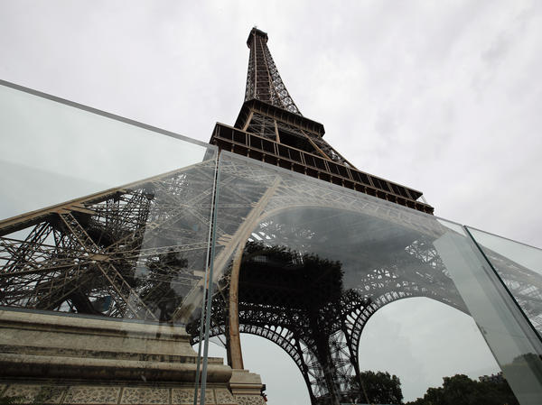 Newly installed panels of bulletproof glass surround two sides of the Eiffel Tower site in Paris. Construction is scheduled to be complete in July.