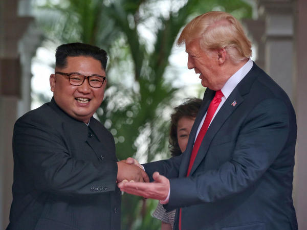 North Korean leader Kim Jong Un shakes hands with U.S. President Trump during their summit on June 12 in Singapore.