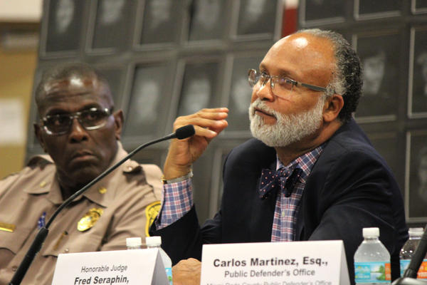Miami-Dade County Court Judge Fred Seraphin speaks about the systemic cycle of poverty and youth gun violence he sees in his courtroom in the Goulds Parks Community Center on Thursday, June 14, 2018.