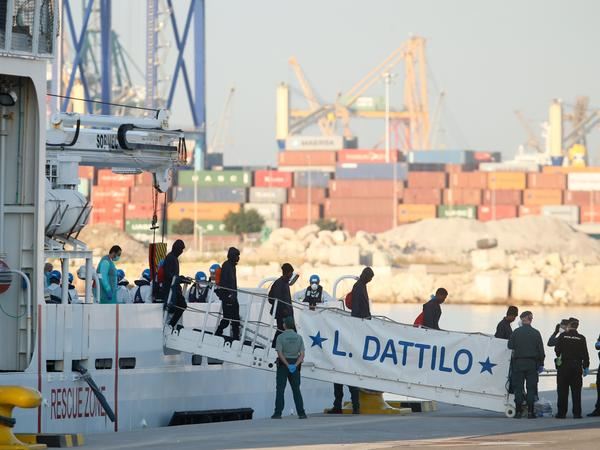 Migrants disembark from Italian coast guard boat the Dattilo at the port of Valencia on Sunday.